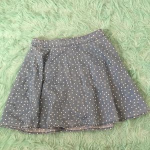 A blue with white pok-a-dots skirt.